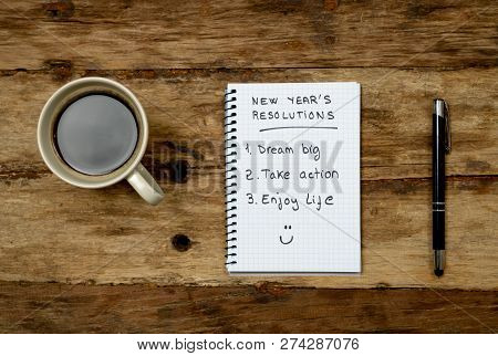 2019 New Year Resolutions Written On Notebook And Coffee On Wood Table In Goals For Happy Life