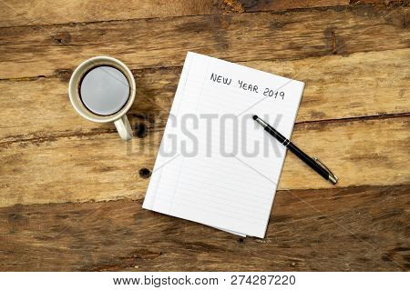 2019 New Year Resolutions Written On Notebook Pen And Coffee On Wood Table In Better Life Goals