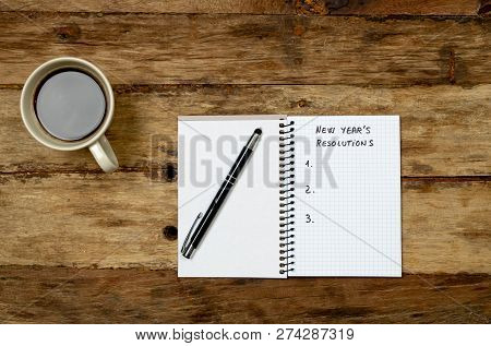 2019 New Year Resolutions Written On Notebook With Gift And Coffee On Wood Table In Better Life Goal