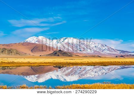 Beautiful Landscape Of Ulgii In Western Mongolia With The River, The Large Yellow Steppe And The Bea