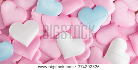 Valentine's Day Hearts Background. Holiday Abstract Valentine Background with pink, white and blue pastel color satin Hearts. Hearts backdrop. Love concept, wedding. Flatlay