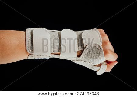 wrist and hand orthotics support for carpal tunnel syndrome healing, isolated on black