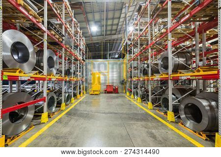 Tiered Rack With Sheet Metal Rolls. Internal Warehouse Of Raw Materials.
