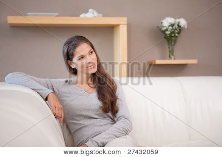 Young woman sitting on the sofa