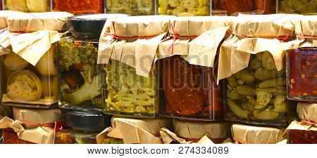 Glass Jars With Spicy Specialties Typical Of Southern Italian Regions Suche As Green Broccoli Tomato