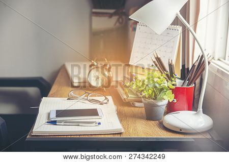 Business Computer Office Desk With Desktop Laptop,notebook,clock,pen And Smart Phone,working Space A