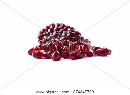 Pomegranate Seeds Isolated On White Background. Ripe Pomegranates Close-up. Sweet And Juicy Garnet W