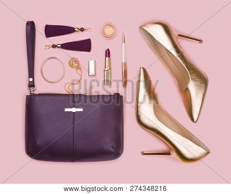 Women Set Of Gold Purple Fashion Accessories On Pink Background