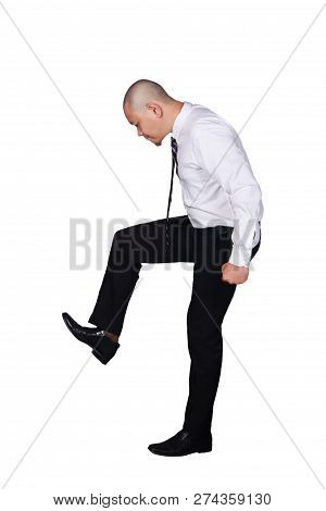 Young Businessman Wearing White Suit And Black Pants Stomping Gesture. Isolated On White. Full Body