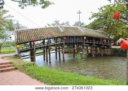 Thanh Toan Bridge, The Ancient Wooden Bridge On The River Perfume Near Hue City, Vietnam