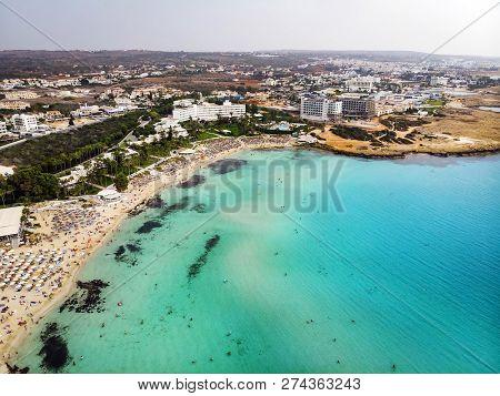 Cyprus Beautiful Coastline, Mediterranean Sea Of Turquoise Color. Houses On The Mediterranean Coast.