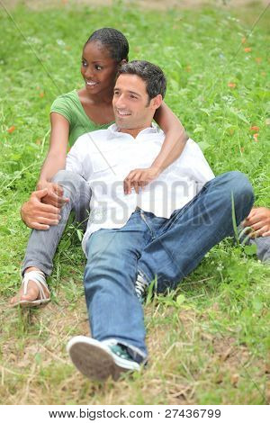 Mixed-race couple in park