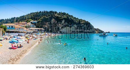People In Summer Holiday On The Seaside Of Agios Nikitas Beach, In Lefkada Island Of Greece - Europe