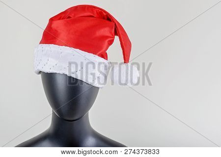 A Head Of Female Mannequin With Santa Claus Hat Isolated On White Background