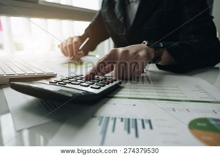 Businessman Or Accountant Hand Holding Pen Working On Calculator To Calculate Business Data, Account