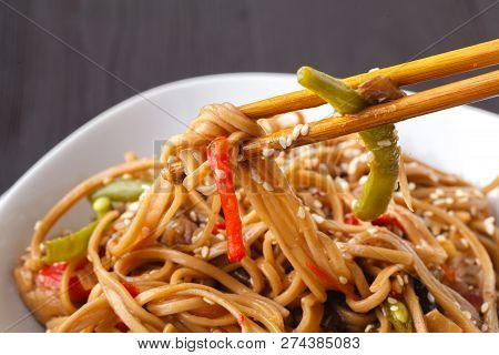 Japanese Famous Foods.yakisoba. Stir-fried Noodles With Chicken And Vegetables.closeup Of Chopsticks