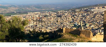 Aerial panorama of the old Medina in Fes at sunset, Morocco (Fes El Bali Medina) poster