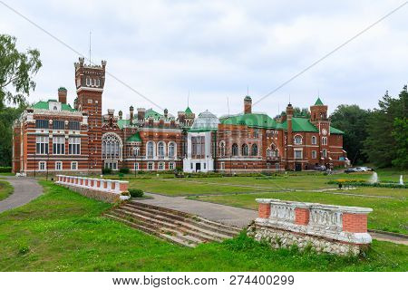 Sheremetev castle palace and park ensemble in the village of Yurino on the bank of the Volga, combination of different architectural styles in one building. Cloudy weather at the beginning of summer. poster