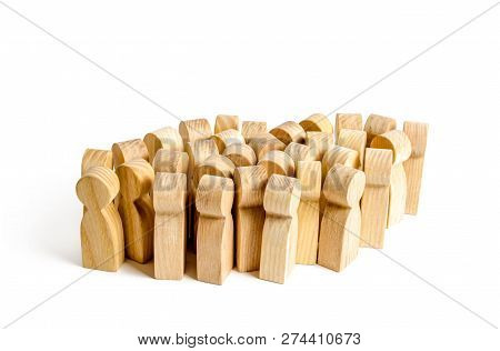 A Large Group Of Wooden Figures Of People. Society, Community. Social Activity. Society, Social Grou