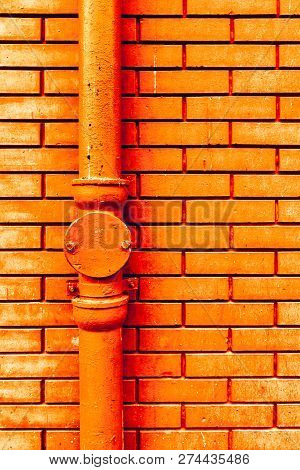 Gutter downpipe and brick wall as urban background poster