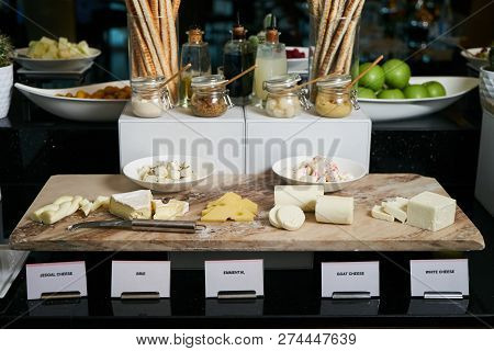 Hotel Restaurant Table With Various Types Of Cheese. Buffet Cate