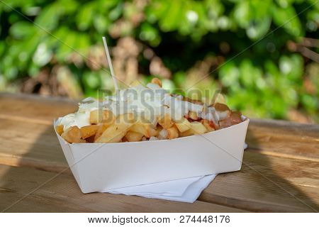 Portion Of Fresh Fried Belgium Potatoes Sticks With Inion, Ketshup And Sate Sauce
