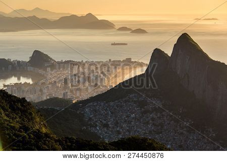 View Of Favela Rocinha At Sunrise With Ipanema District Behind, In Rio De Janeiro, Brazil