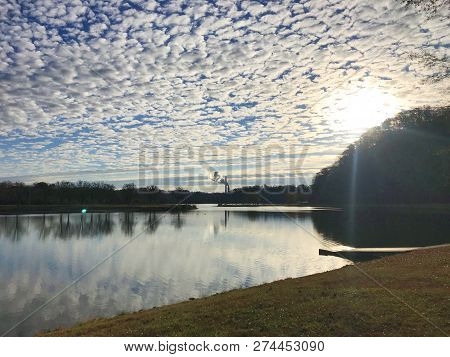 View Of Oak Ridge Marina Bay With Fluffy Clouds And Fall Colors In Oak Ridge, Tennessee.