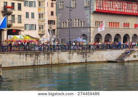 Zurich, Switzerland - August 2, 2014: Embankment Of The Limmat River During The Street Parade. The S