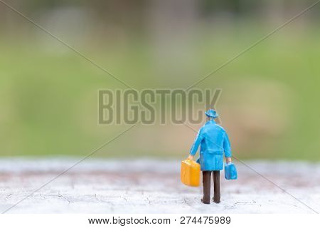 Miniature People : Traveler Walking On Street  , Travel And Adventure Concepts.