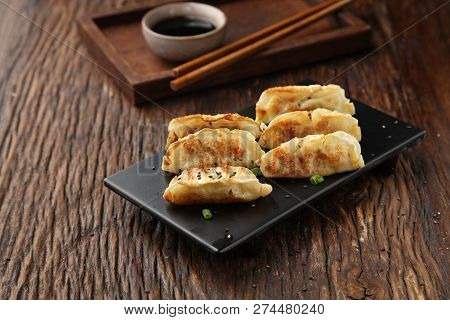 Japanese Fried Dumpling On A Black Plate