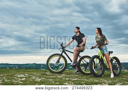 Afternoon Sunset With Mountainbike Couple. Side View