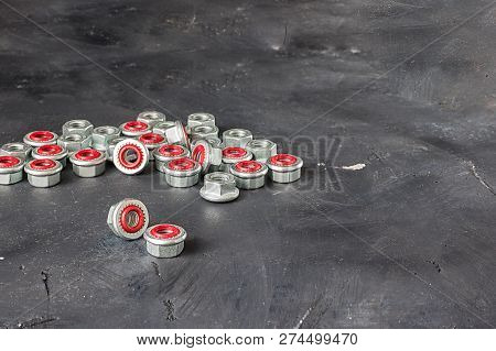 Many Metal Grey And Red Inside Seal Locks For Hermetization Of Carving For Liquid And Gas Fluid On T