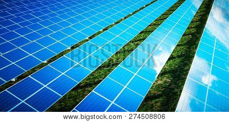 Beautiful Reflection Of Clouds On Blue Solar Cells Of A Large Solar Farm In A Warm Late Afternoon Li