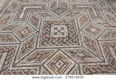 Geometric Mosaic Of The Roman Ruins Of The Ancient City Of Conimbriga, Beiras Region, Portugal