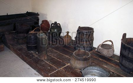 A Wooden Vat For Grape-stomping, Buckets And Other Antique Household Items In The Basement Of A Trad