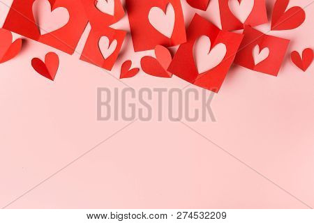 Beautiful Valentines Day Paper Hearts On Pink Background. View From Above. Valentines Day Concept.