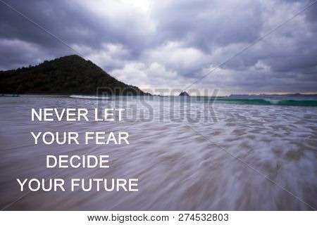 Inspirational Quote-Never let your fear decide your future. With hill and rushing wave in the beach as landscape background. poster