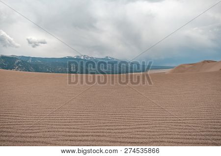 Layers Of Sand, Sand Texture, With Stormy Skies In Great Sand Dunes National Park In Colorado, Usa