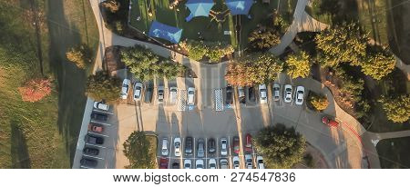 Panoramic Top View Crowed Parking Lots Near Community Playground In Texas, America