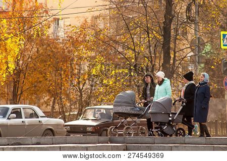Yekaterinburg, Russia.october 15 2017-young Couple Is Walking Around The Autumn City With A Stroller