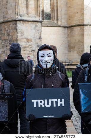 York, Uk - December 8, 2018.  Members Of The Cube Of Truth Vegan Protest Group In Guy Fawks Masks An