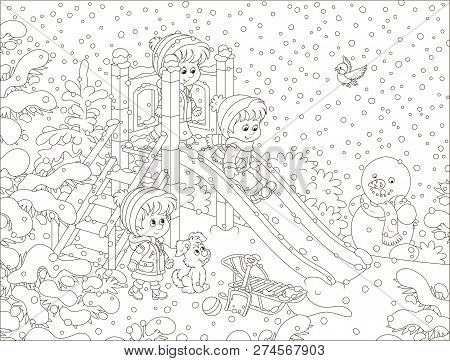 Children Playing On A Slide At A Snow-covered Playground In A Winter Park On A Snowy Day, Black And