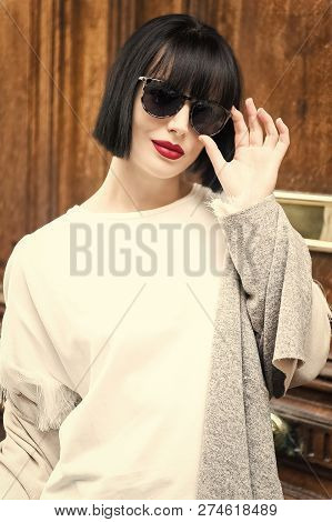 Look And Retro Style. Woman With Stylish Short Brunette Hair And Red Lips. Parisian Fashion Model Po