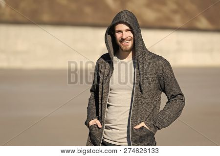 Bearded Man Smile In Hood On Sunny Outdoor, Fashion. Macho Happy Smiling In Sweatshirt, Casual Style
