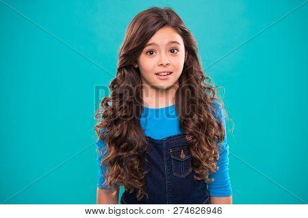 Perfect Curling Hair. Teaching Healthy Hair Care Habits. Kid Girl Long Healthy Shiny Hair. Kid Happy