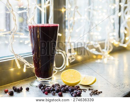 Fruit Red Tea With Wild Berries In Glass Cup On Bright Background
