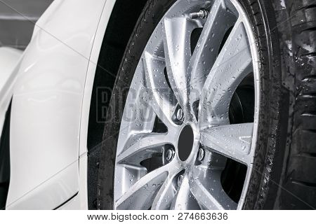 Cars In A Carwash. Car Wash With Foam In Car Wash Station. Carwash. Washing Car Wheel At The Station