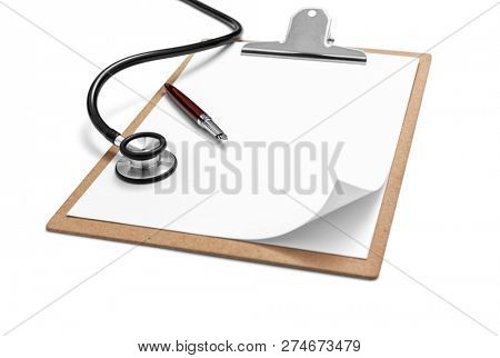 Stethoscope and clipboard with pen on white background, included clipping path