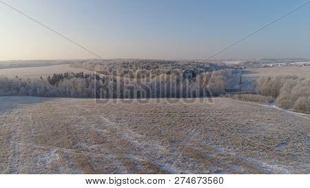 Aerial View Winter Landscape Snow Covered Field And Trees In Countryside. Winter In Countryside. Sno
